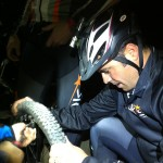 Repairing a bike flat at night