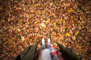 person standing in a pile of leaves