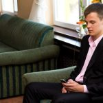 man checking his phone