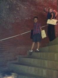 Dark-lit rounded stairwells.