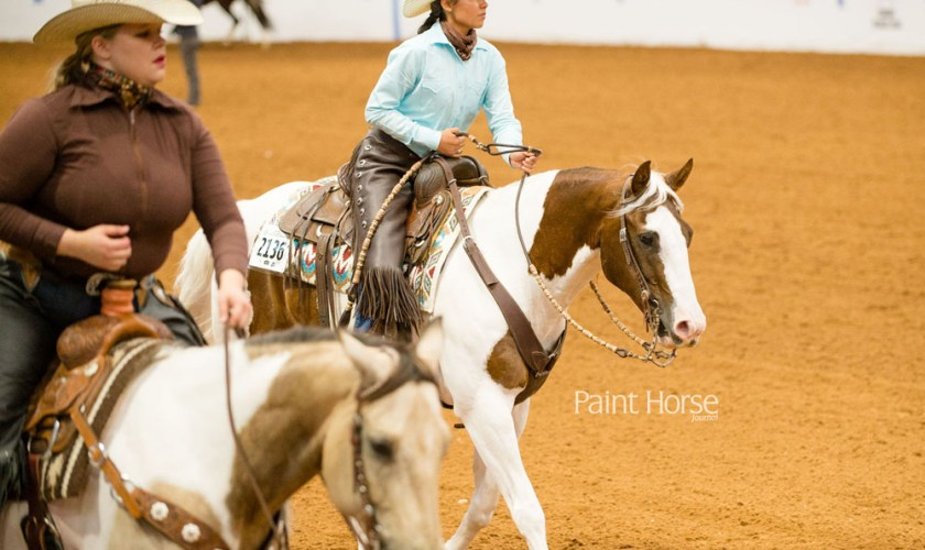 woman riding a paint horse