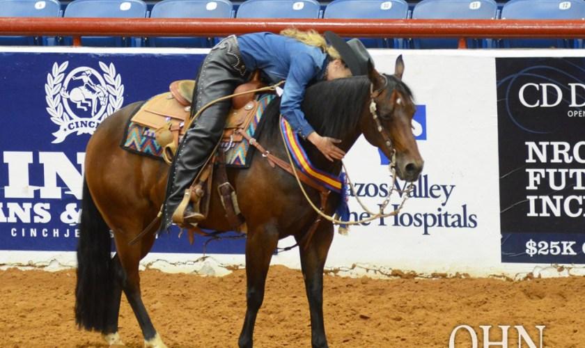 Woman hugging a horse