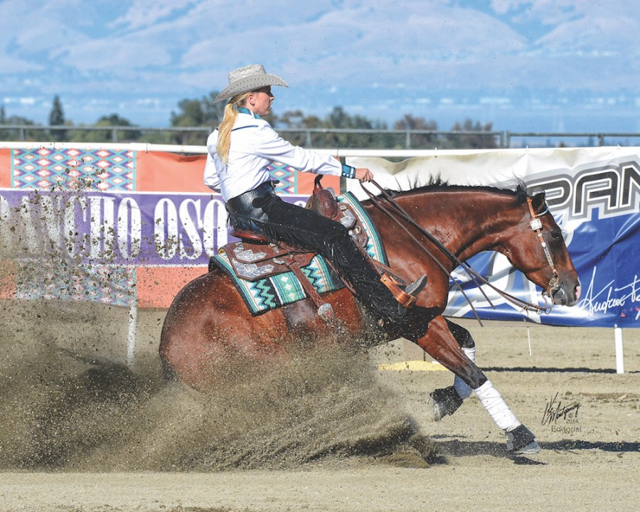 Kelly Moran doing a sliding stop at Reining by the Bay