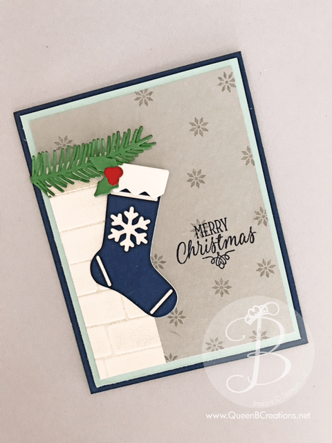 Stampin' Up! Hang Your Stocking stamp set and Christmas Stocking Framelits were used to make this cute Christmas card by Queen B Creations