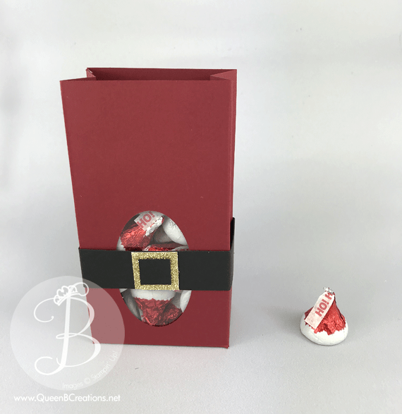 A handmade gift bag of Santa Kisses made with Stampin' Up! supplies and Hershey Kisses by Queen B Creations