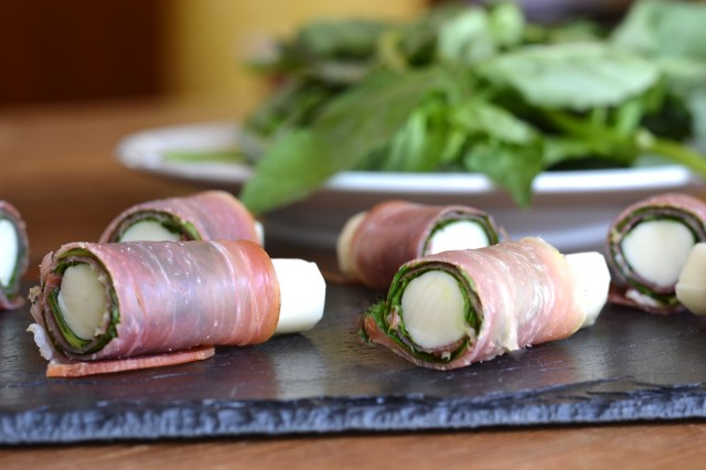 Prosciutto and Basil Wrapped Mozzarella Sticks - A simple appetizer that takes less than 10 minutes to makes.  Less than 100 calories with 10 grams of protein.  Great for antipasto platters. | QueenofMyKitchen.com | #appetizer #appetizers #easyappetizer #antipasto