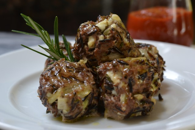 The wild rice in these meatballs takes the place of bread crumbs and makes them gluten free. Garnish with fresh rosemary. Serve with Roasted Garlic Ketchup. | QueenofMyKitchen.com