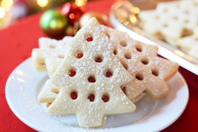 Decorating Christmas Cookies.Raspberry Filled Christmas Tree Cookies