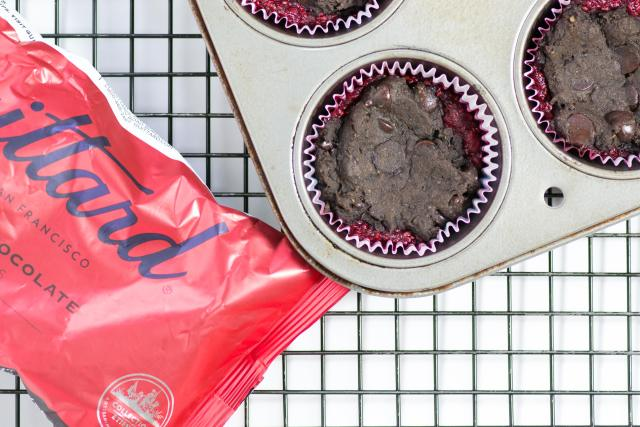 Raspberry Chia Black Bean Brownie Cups - Raspberry chia jam nestled inside a dark chocolate, fudge-like brownie. Gluten-free, low in sugar, high in fiber. | QueenofMyKitchen.com