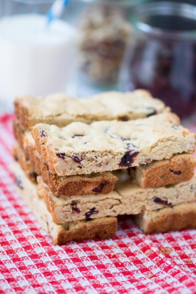 Paleo Cranberry Walnut Bars are delicious maple infused treats with a soft texture and sweet, tart, cranberry flavor. Gluten-free with no refined sugar. | QueenofMyKitchen.com