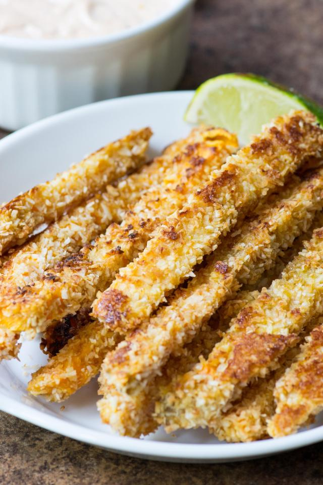 Coconut Crusted Sweet Potato Fries - Golden, crispy, and delicious sweet potato fries baked in a coconut crust. | QueenofMyKitchen.com