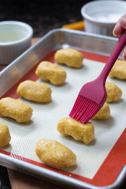 Chickpea Cheddar Tots – There's a new tot on the block! Nuggets of cheddar cheese encased in a gluten-free chickpea crust and baked to golden perfection. Served with mustard, these tots make a great, healthy snack for kids and adults. | QueenofMyKitchen.com