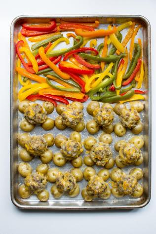 Basil Cheddar Quinoa Meatballs Sheet Pan Meal with Baby Potatoes and Roasted Bell Peppers - Baby potatoes are the rack for savory meatballs in this unique sheet pan meal. Sweet roasted bell peppers are the perfect complement to this intensely flavored dish. | QueenofMyKitchen.com