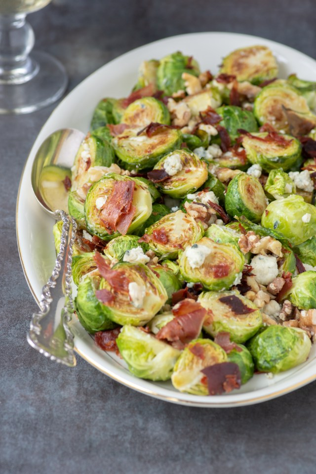 Blue Cheese Brussels Sprouts with Walnuts and Crispy Prosciutto - Roasted Brussels sprouts get a boost of flavor from pungent blue cheese and salty prosciutto. An easy and impressive side dish perfect for holiday entertaining. | QueenofMyKitchen.com | #brusselssprouts #wintervegetable #wintervegetables #side #sides #vegetables #holidaydinner