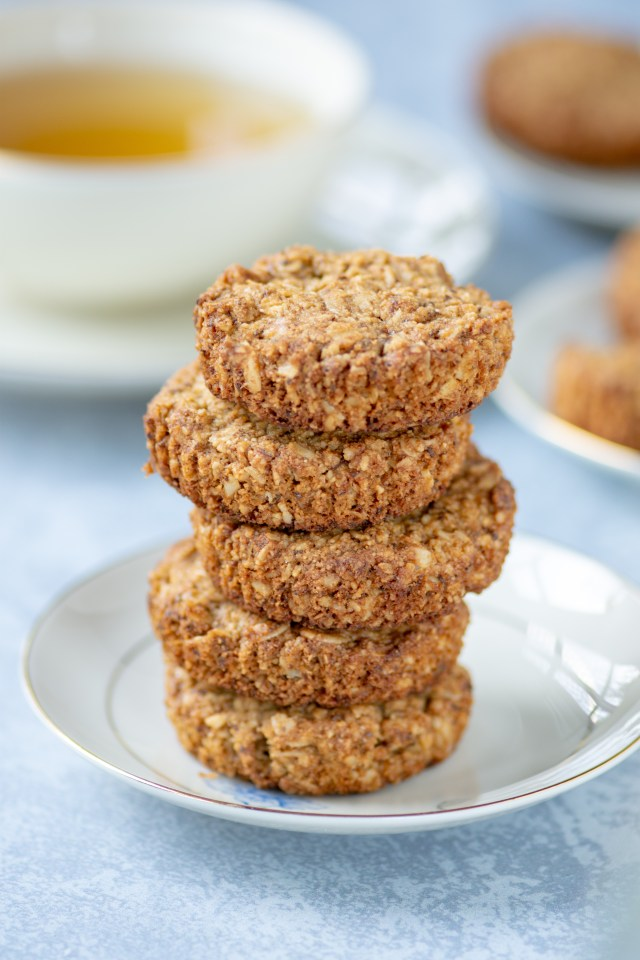 Almond Oat Cups - A cross between a cookie, a muffin, and a teacake. Gluten-free, egg-free, and only take 10 minutes to bake. Perfect as a healthy snack or with a cup of tea.   QueenofMyKitchen.com   #glutenfree #glutenfreesnack #glutenfreebaking #glutenfreesnack #oatcups #eggfree #eggfreebaking