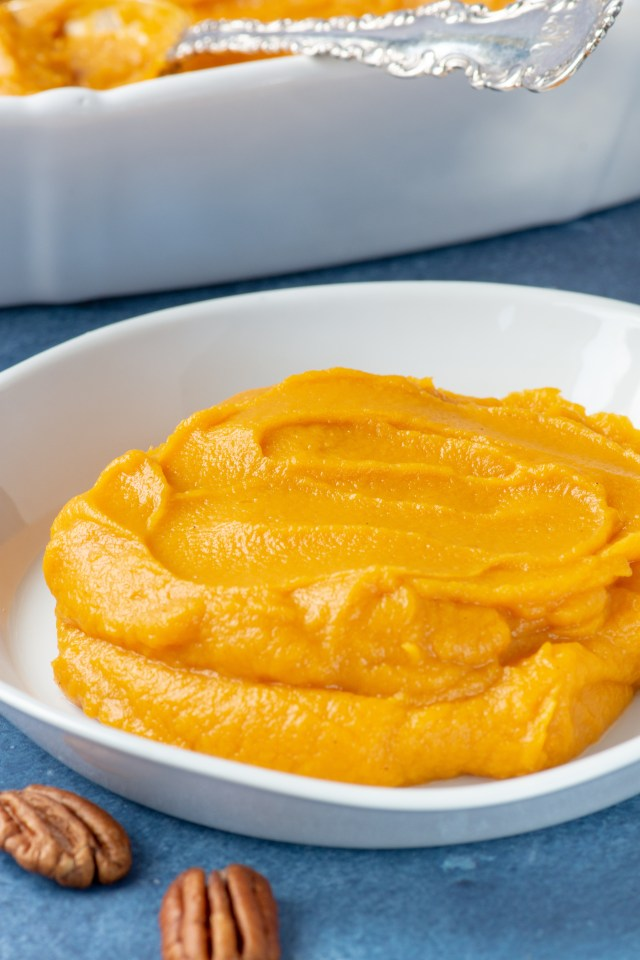 Maple Mashed Sweet Potatoes with Bourbon and Pecans - A super simple recipe that makes the ultimate smooth and creamy sweet potatoes.  Perfect any time of year but especially for the holidays.   QueenofMyKitchen.com   #side #sidedish #Thanksgiving #potatoes #bourbon #sweetpotatoes