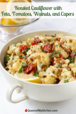 Roasted Cauliflower with Feta, Tomatoes, Walnuts, and Capers - Cauliflower gets dressed up in this vibrant side dish with a variety of flavors, colors, and textures. Super simple to prepare. Great as an appetizer too. Gluten-free. | QueenofMyKitchen.com | #vegetables #vegetable #sidedishes #sidedish #thanksgiving #glutenfree #yummyveggies #cauliflowerrecipes