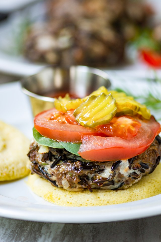 Oven Roasted Gorgonzola Wild Rice Hamburgers - Wild rice gives these delicious beef burgers an earthy texture while Gorgonzola cheese and fresh rosemary deliver a big punch of flavor. These hassle-free hamburgers are cooked in the oven and ready to eat in about 10 minutes. | QueenofMyKitchen.com | #hamburger #hamburgers #burger #burgers #wildrice #ovenroasting
