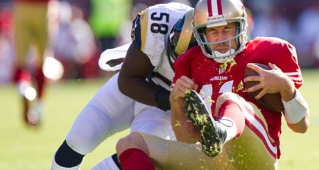 San Francisco 49ers quarterback Alex Smith is tackled by St Louis Rams linebacker Jo-Lonn Dunbar