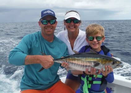 Family with yellow fin tuna