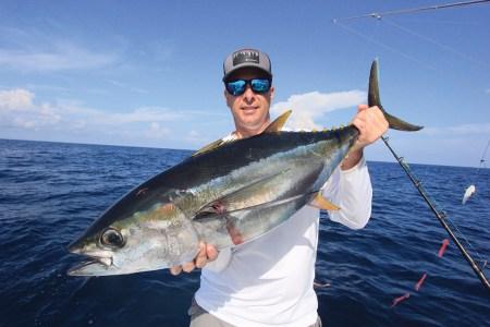 Man holding a tuna.