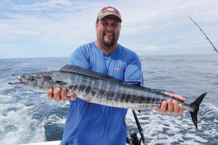 Man holding mackerel