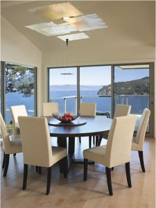 Large dining table with ocean view