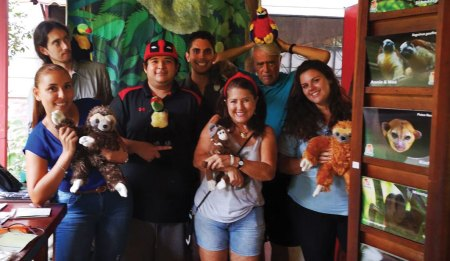 Volunteers with stuffed animals