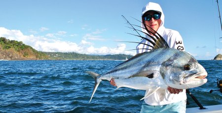 man holding a large roosterfish