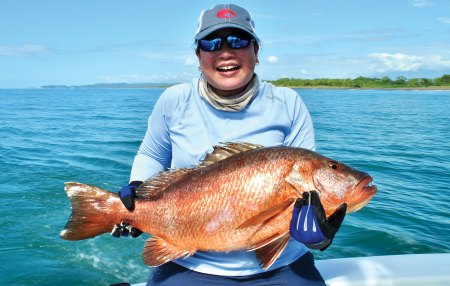 Woman holding a snapper