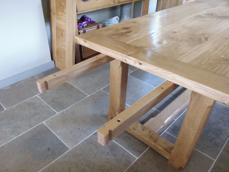 Pippy Oak Table Extension Arms Up Close