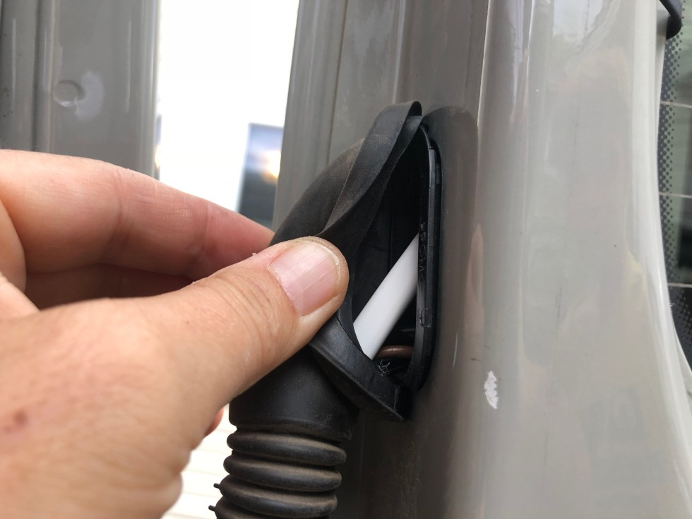 Our 14 awg wire run through the rubber boot on the rear doors of our Sprinter van