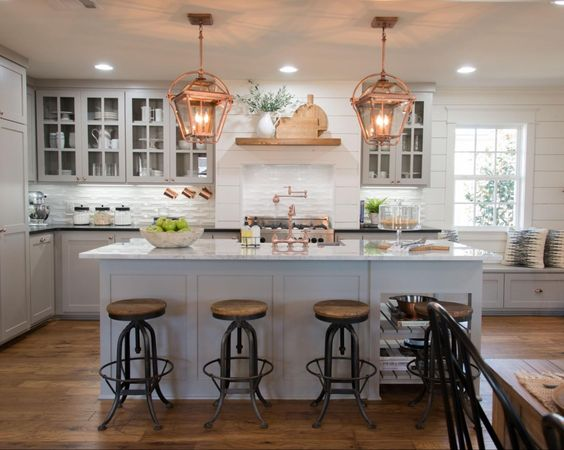 Neutral tone kitchen with copper and greenery detail