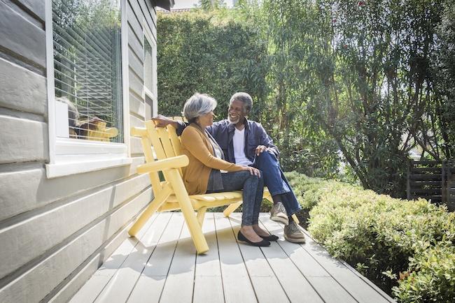 Senior couple sitting on porch