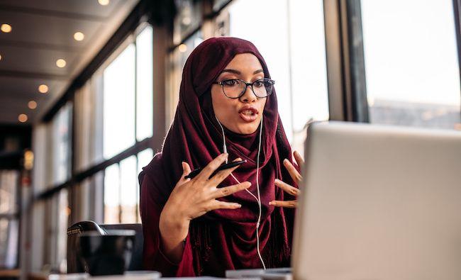 Woman explaining something on a webinar.