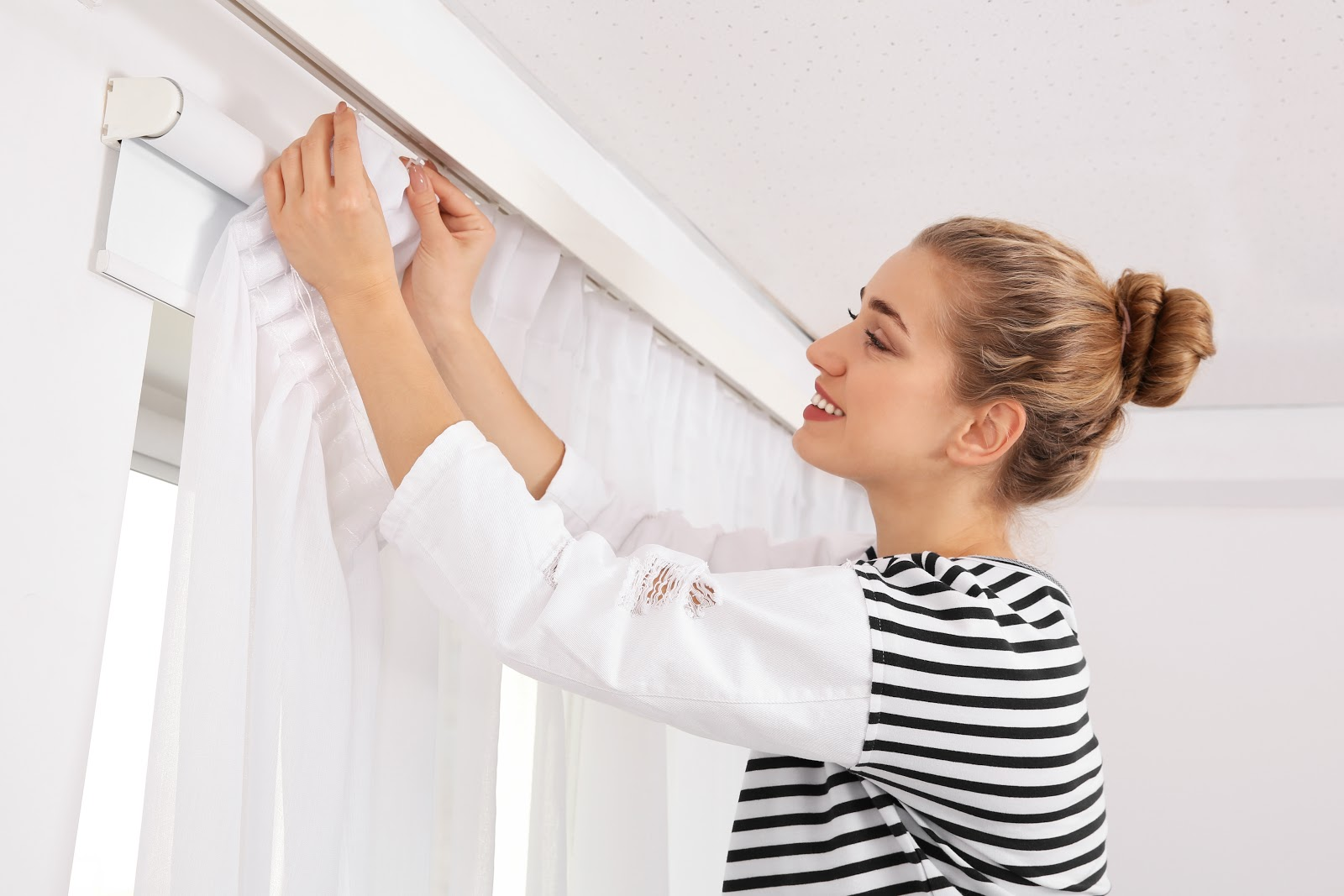 how to install curtain track gliders