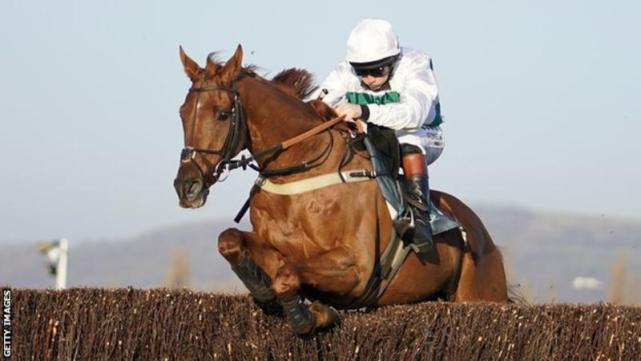 Jamie Moore rides Baron Alco to victory in Cheltenham