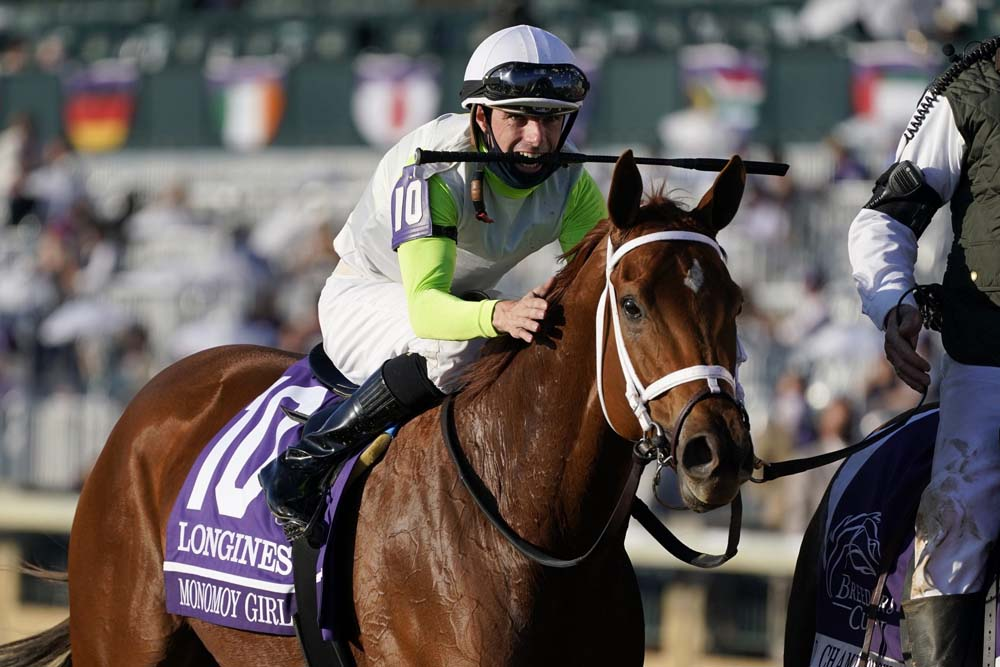Florent Geroux celebrates after riding Monomoy Girl to win the Breeders' Cup Distaff