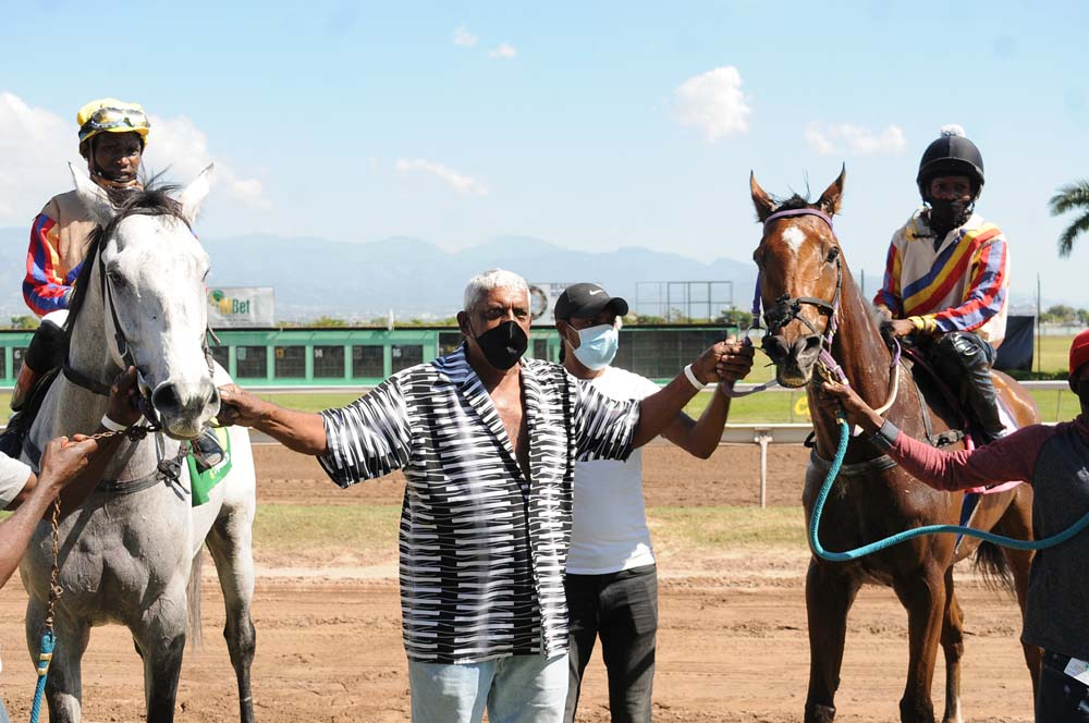 Trainer Cashbert Khwalsingh with his one-two finishers Kuminous Power (left) and Alexa's Song