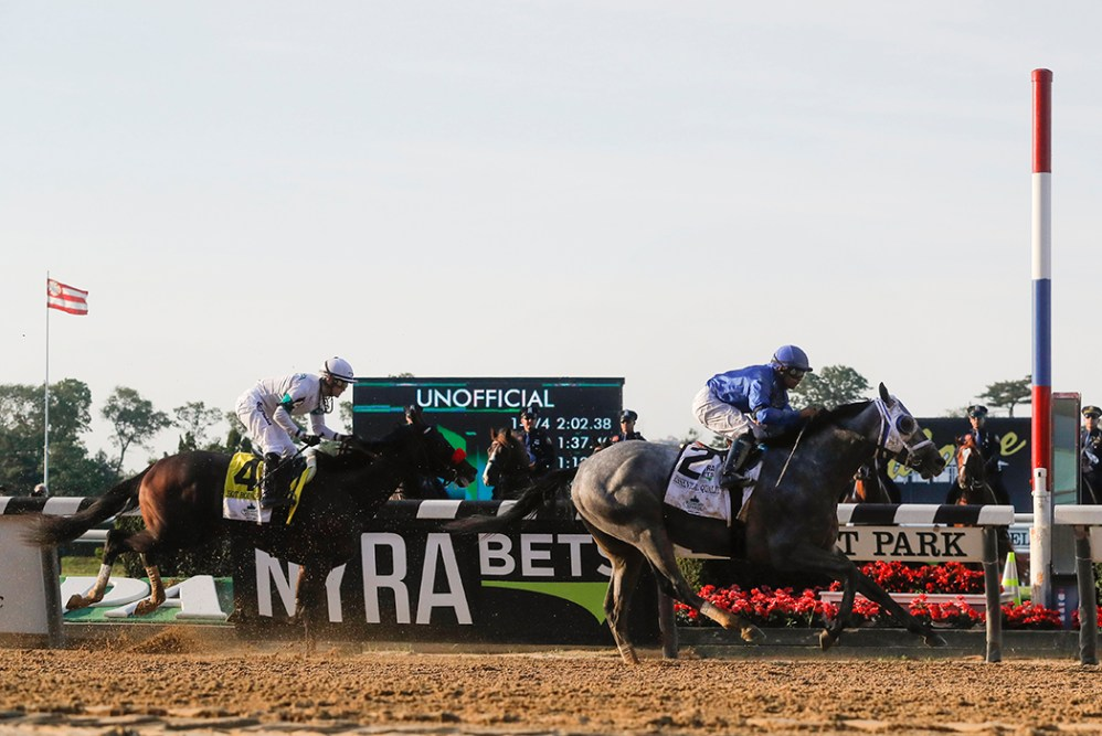 Essential Quality (2), with jockey Luis Saez up, crosses the finish line ahead of Hot Rod Charlie (4), with jockey Flavien Prat up, to win the 153rd running of the Belmont Stakes horse race, Saturday, June 5, 2021, At Belmont Park in Elmont, N.Y.