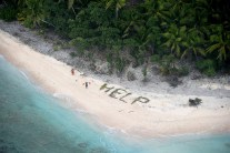 3 rescued island castaways spelled 'help' with palm fronds