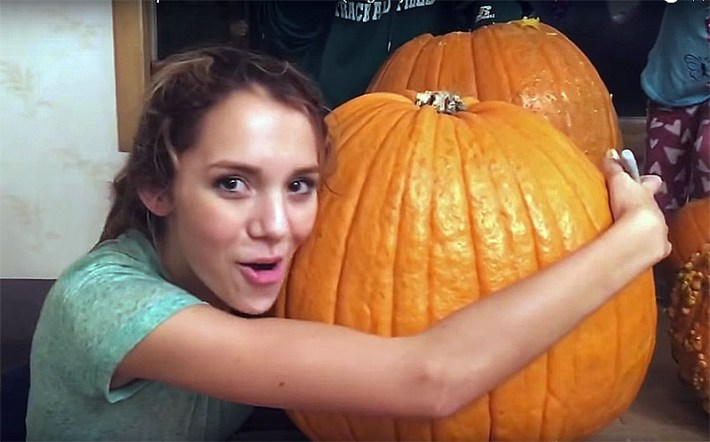 Teen gets her head stuck inside a giant pumpkin!