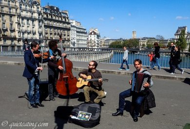 While stopping to listen to the street music