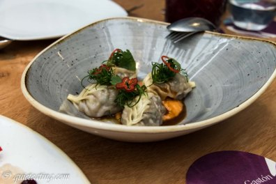 Nikkei dumplings, filled with beef and cilantro, creamy corn pepian and spicy broth