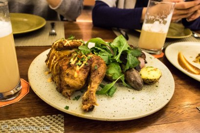 Wood fired chicken, baked in an oven with potatoes and onions
