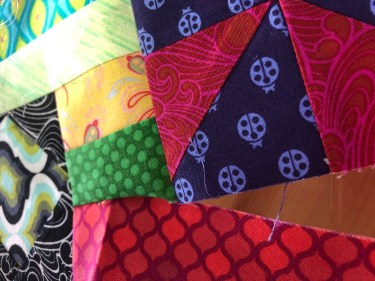 This photo shows a section of TheGypsy Wife Quilt at a partial seam intersection.