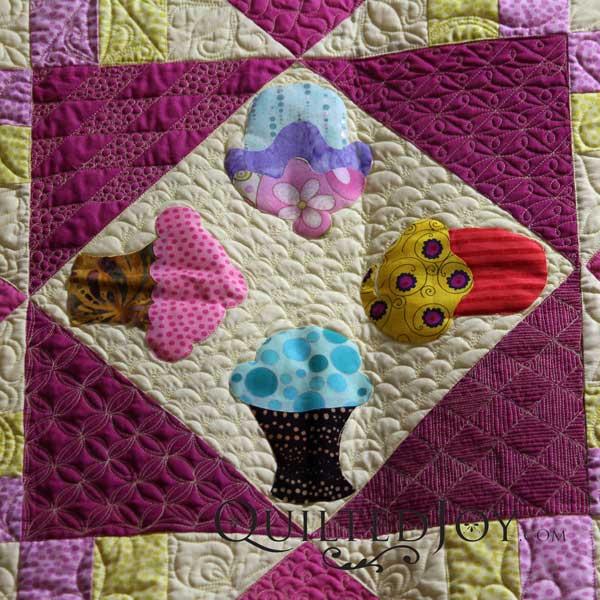 Grid based filler quilting design. Quilted by Angela Huffman on APQS Millennium longarm quilting machine.