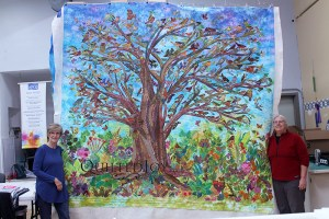 A stunning Wall Hanging for a local church depicting a tree featuring hand dyed fabrics and hand embroidery