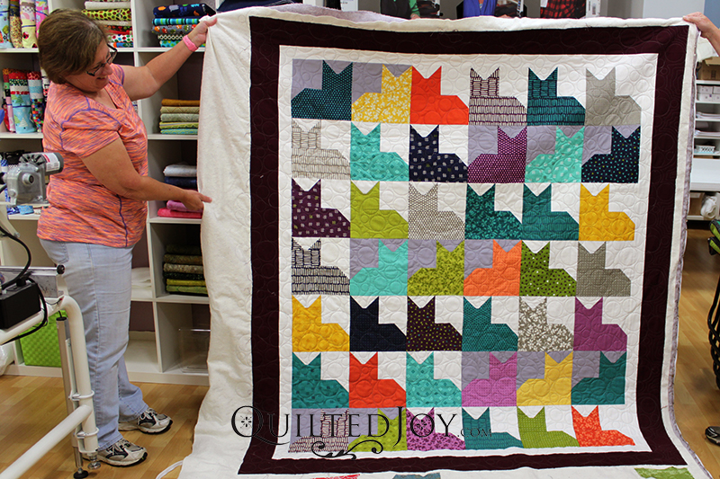 How fun is Judy's Pins and Paws quilt? She quilted it with a bubbles design board at Quilted Joy