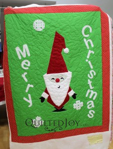 Valerie designed this adorable Santa wallhanging quilt herself! She said it was inspired by a Christmas card.